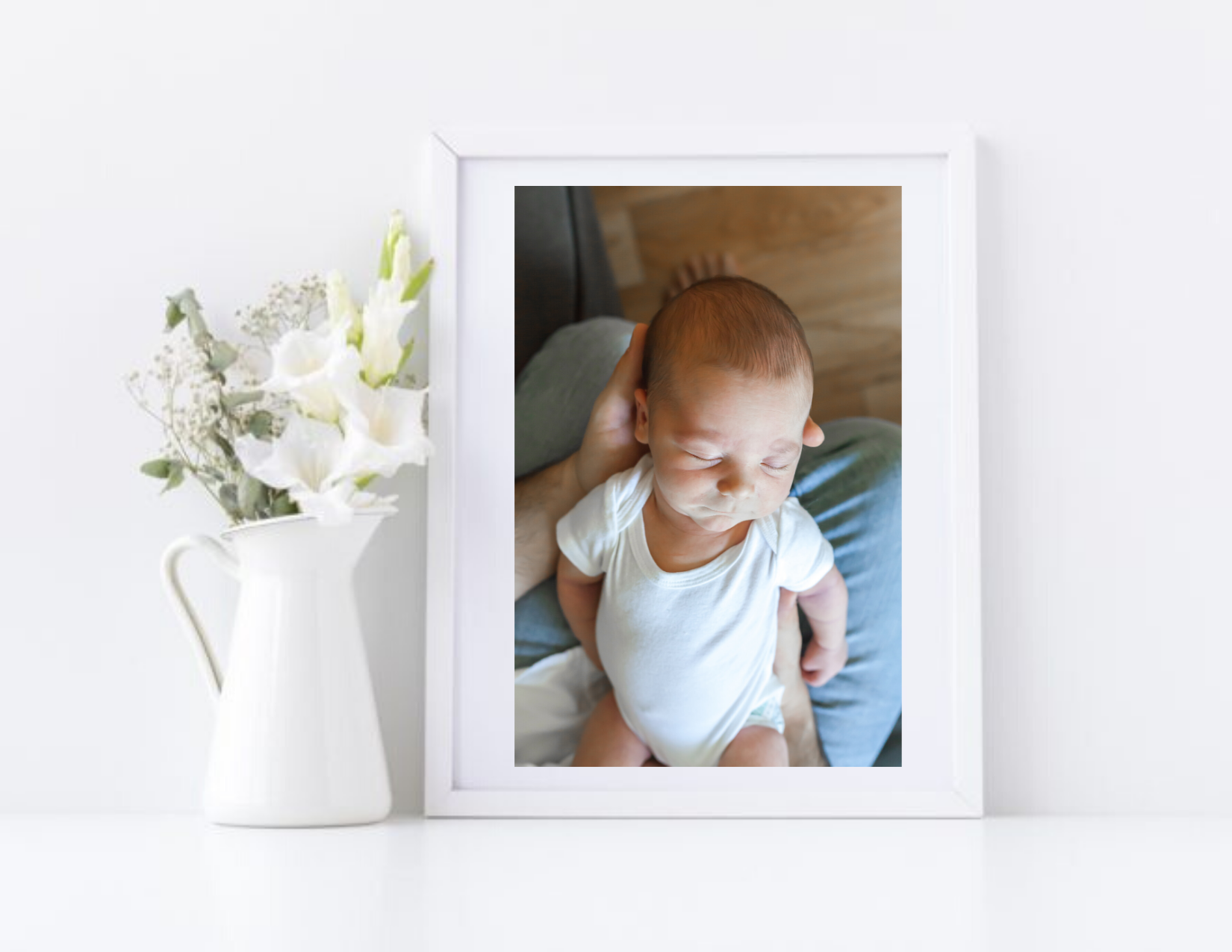 photo of newborn baby boy in picture frame