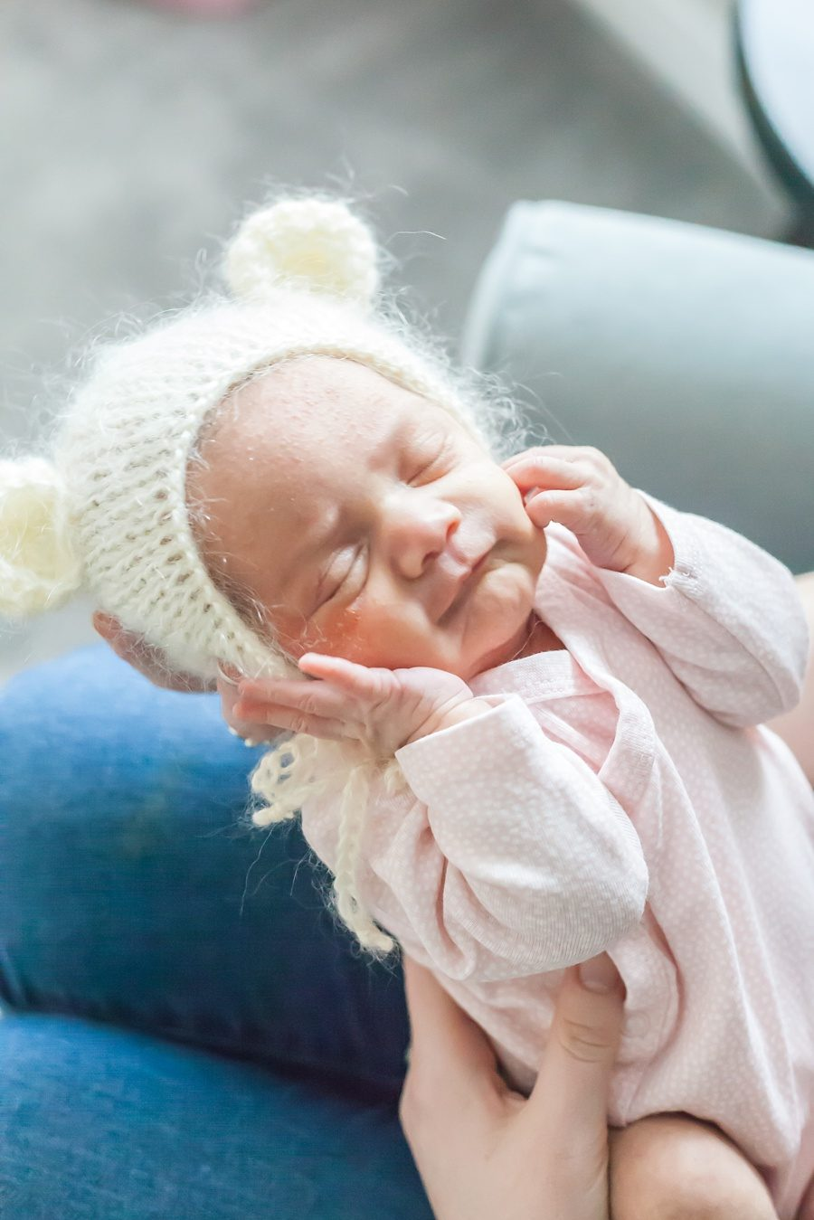 newborn baby in home newborn photo session with bear bonnet conroe texas