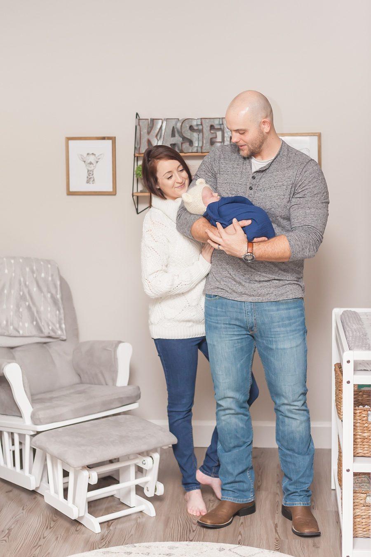 newborn family photo session featuring mom dad newborn in nursery spring texas