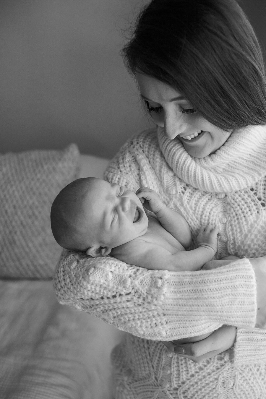 in-home newborn natural light photo session with mom and newborn tomball tx
