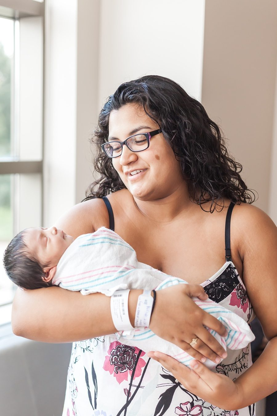 newborn hospital photo session with mom in floral nightgown