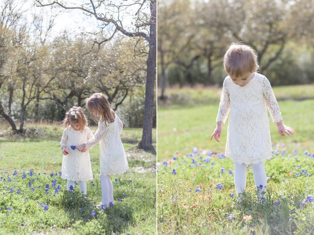 sisters playing in flowers bluebonnet photo session
