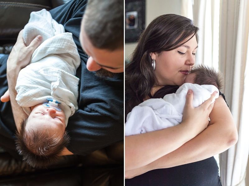 parents holding newborn baby during at-home newborn session