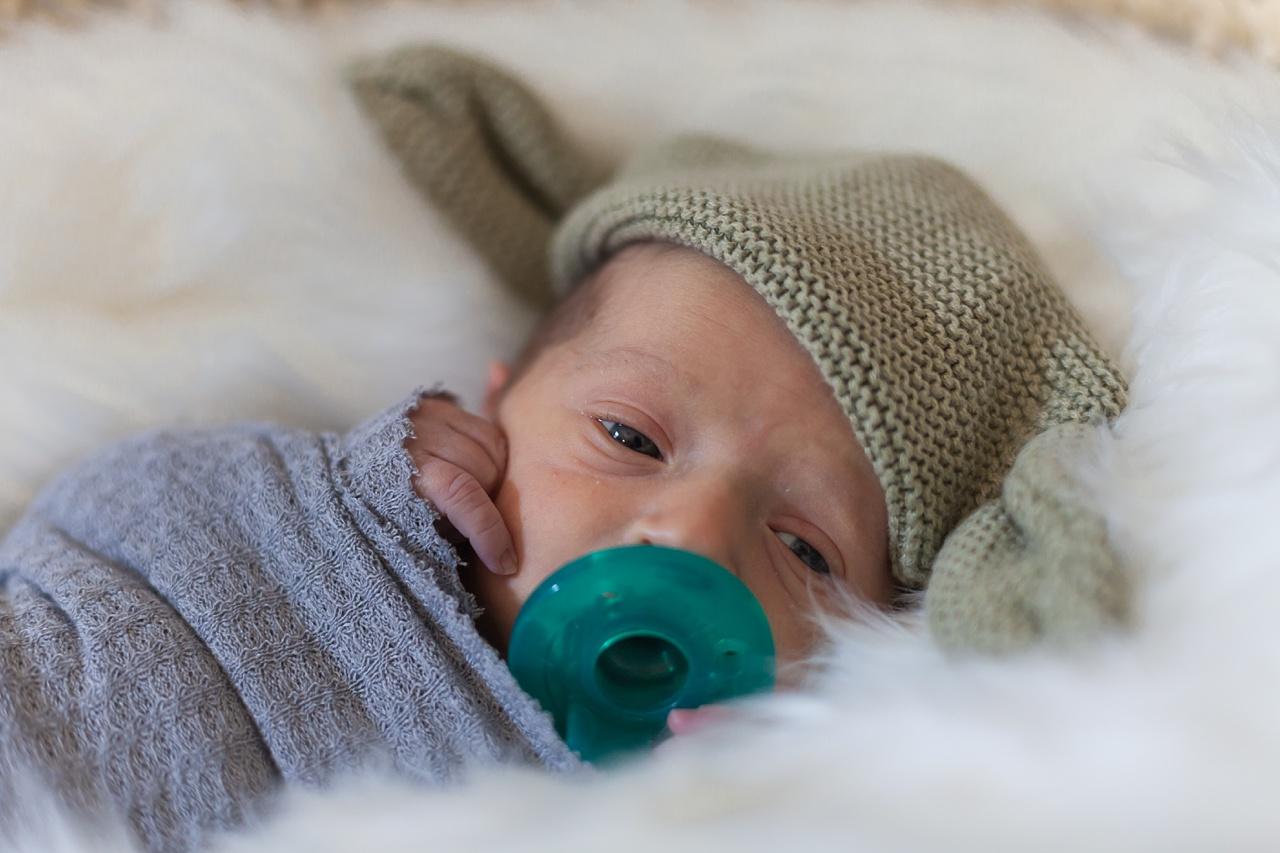 newborn boy with yoda hat