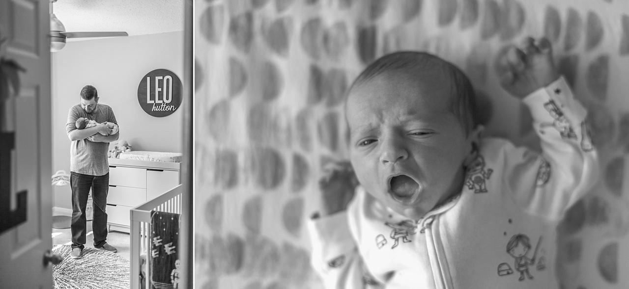 new baby yawns in crib during newborn portraits
