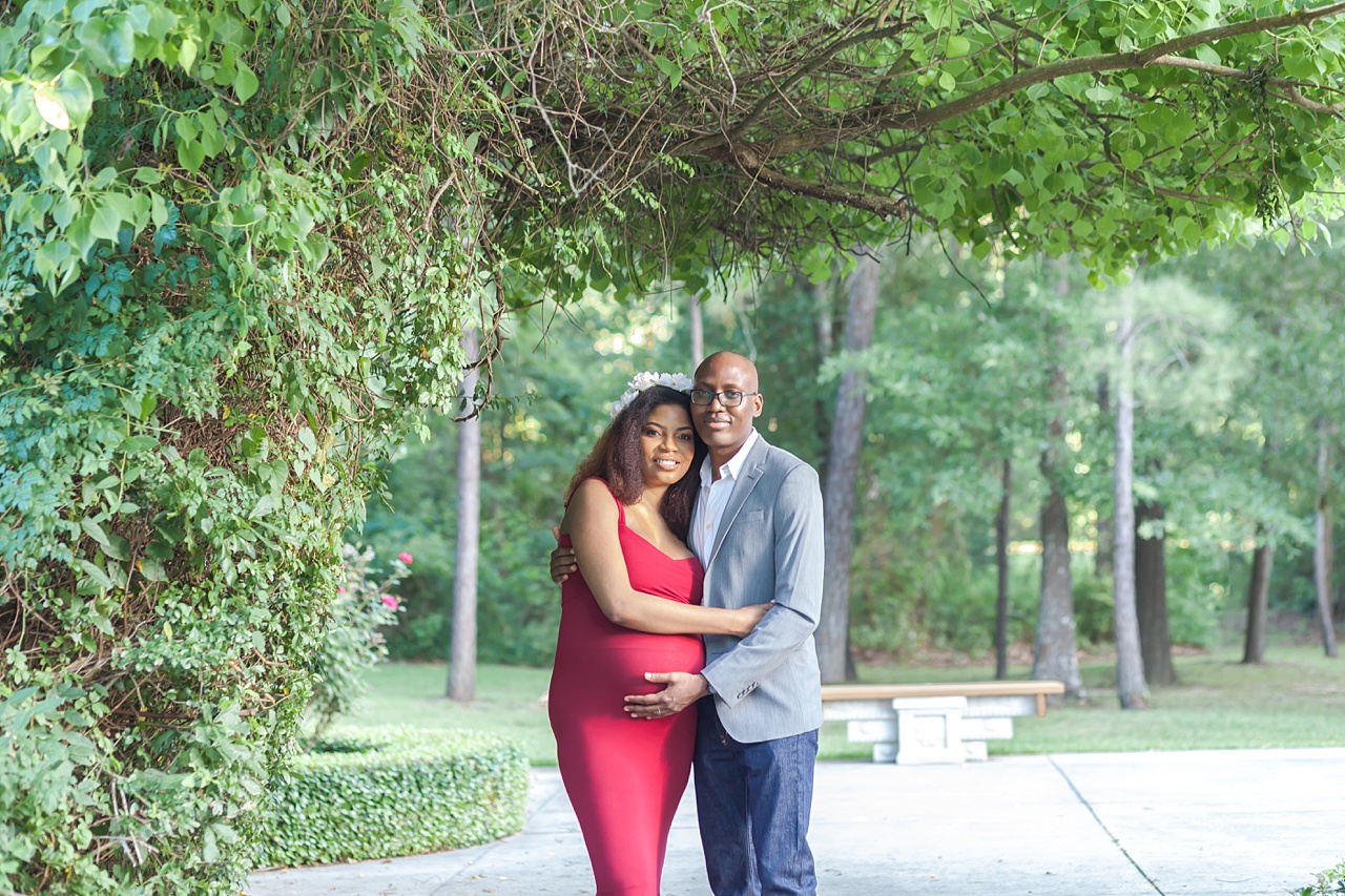 maternity session featuring first-time parents during a photography session in the woodlands texas