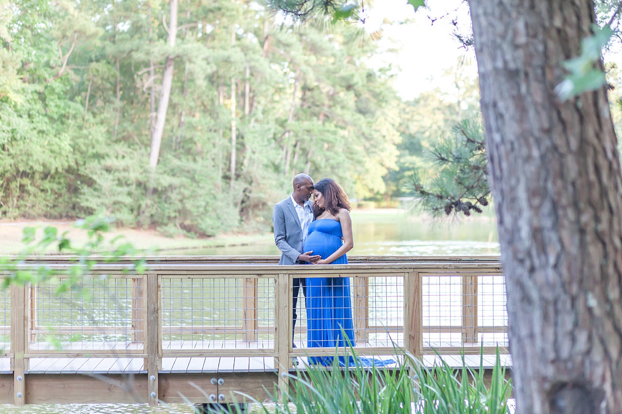 beautiful couple expecting their first baby share a private moment during maternity session in the woodlands, texas, photographed by kristal bean photography