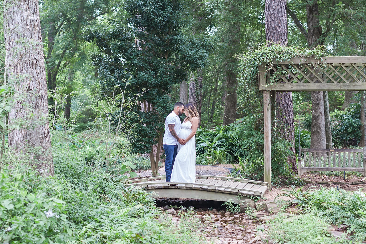 outdoor couples maternity session in beautiful garden by kristal bean photography