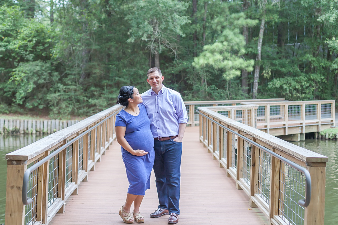 romantic maternity session on a wooden bridge in the woodlands texas