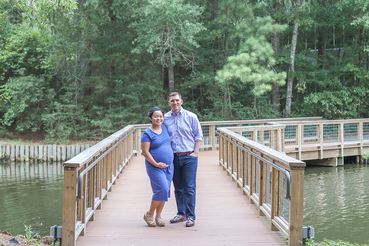 first-time parents schedule maternity pictures in the woodlands texas