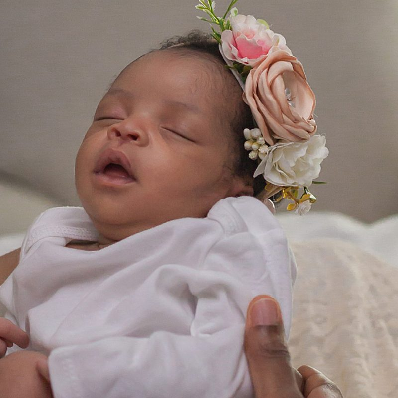 beautiful newborn wearing flower crown during newborn photo session by kristal bean