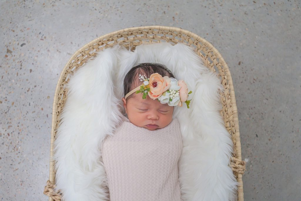 newborn girl in flower crown by kristal bean photography