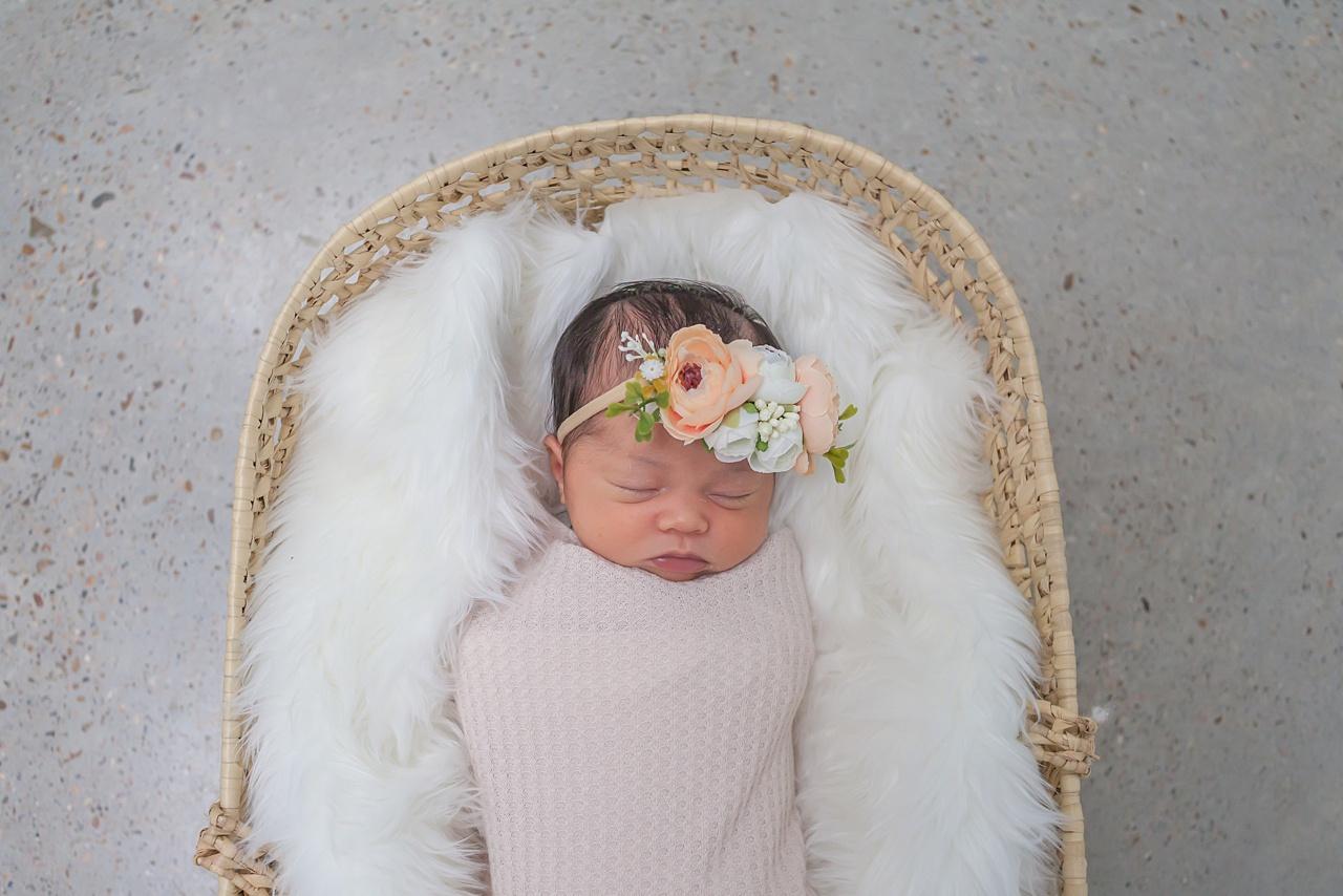 newborn girl in flower crown by kristal bean photography