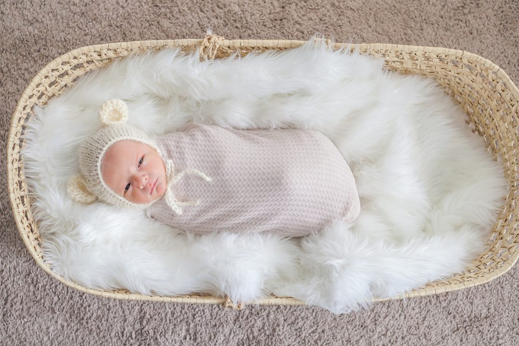 brand new baby boy swaddled in moses basket by kristal bean photography
