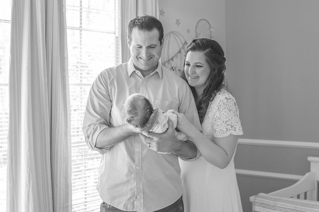 elegant newborn session featuring new parents holding baby by kristal bean photography