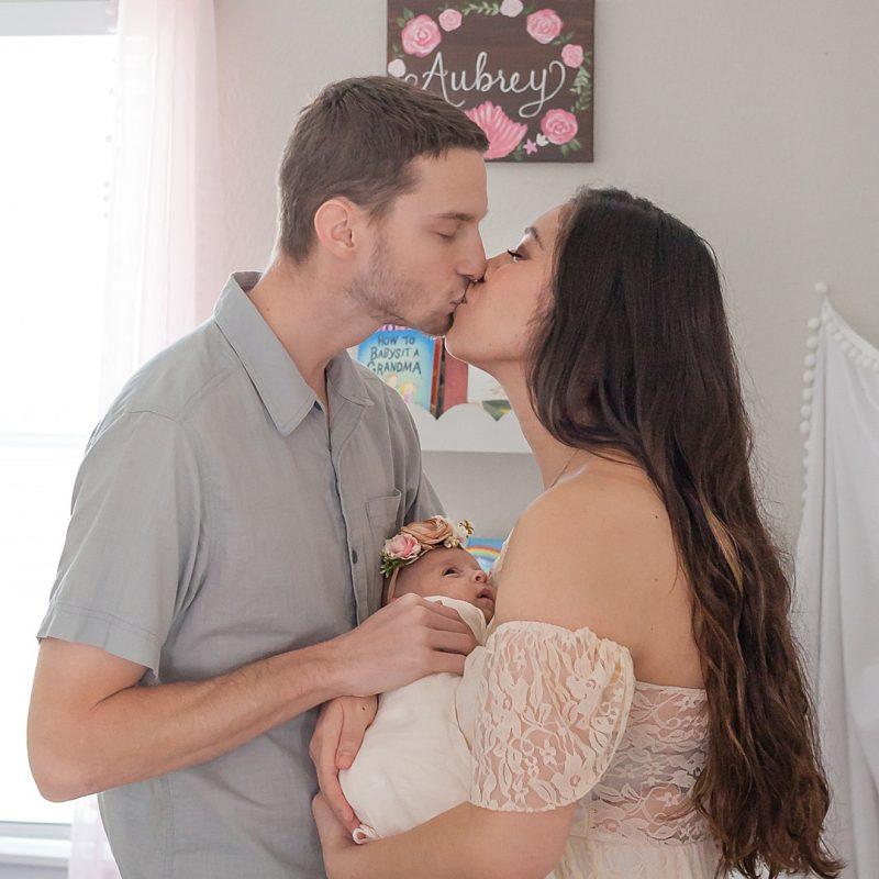 Conroe texas in-home newborn photos featuring mom, dad and newborn girl