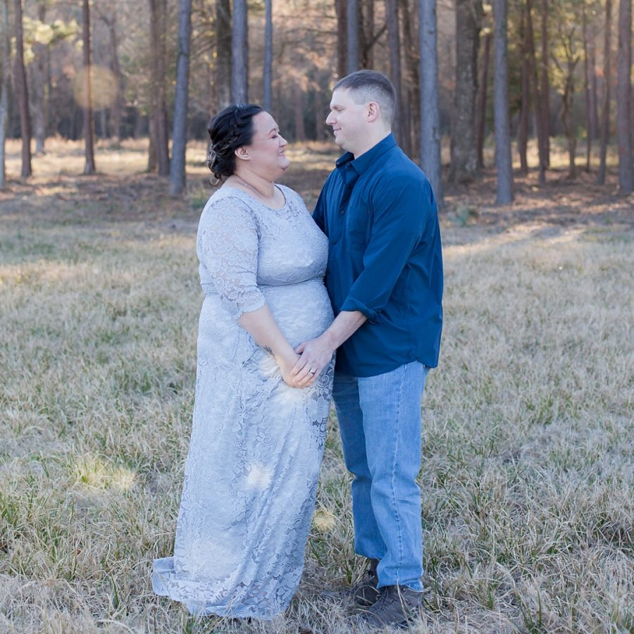 outdoor maternity session with mama in a silver blue gown by kristal bean photography in the woodlands texas