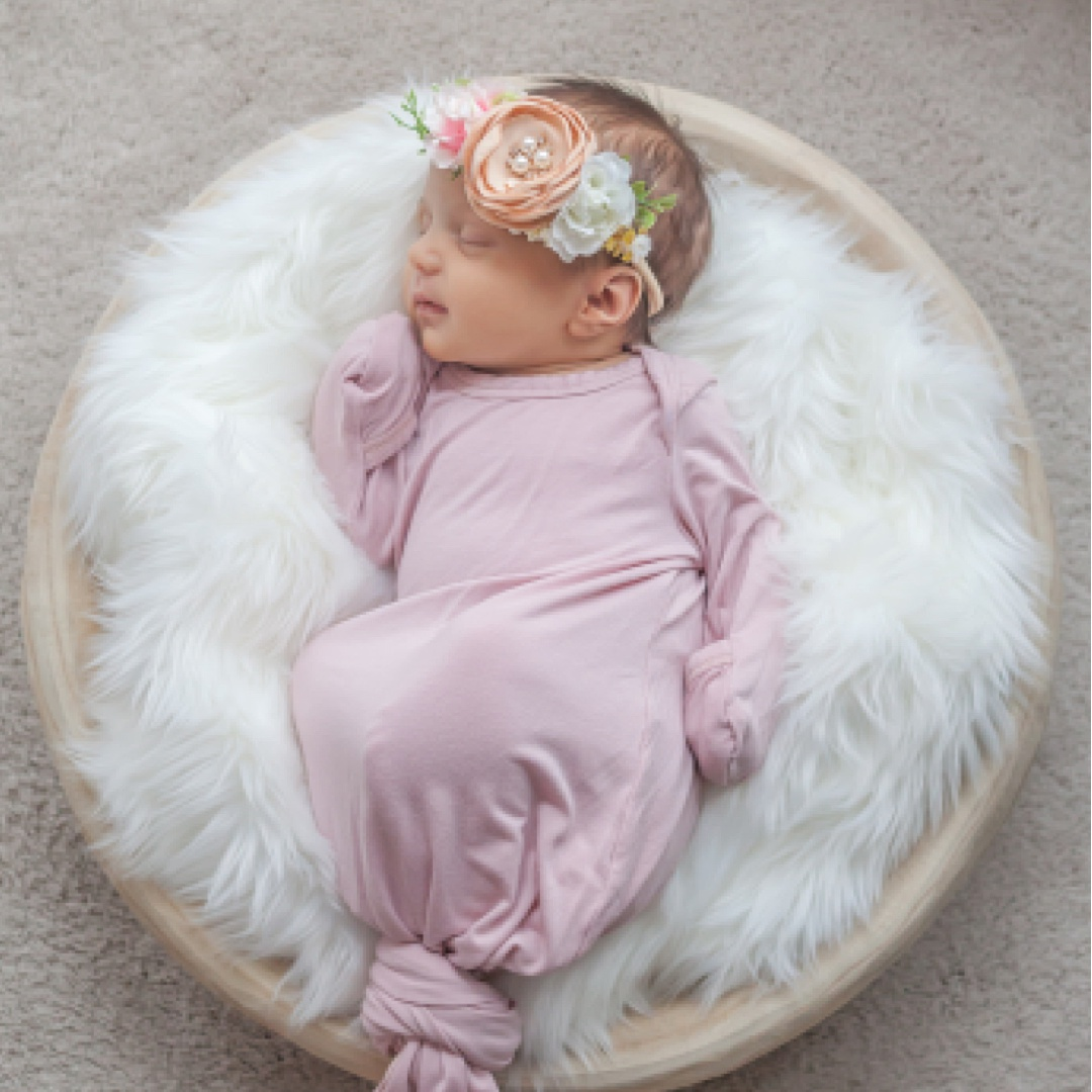 beautiful portrait of newborn baby girl in pink gown and flower crown by kristal bean photography