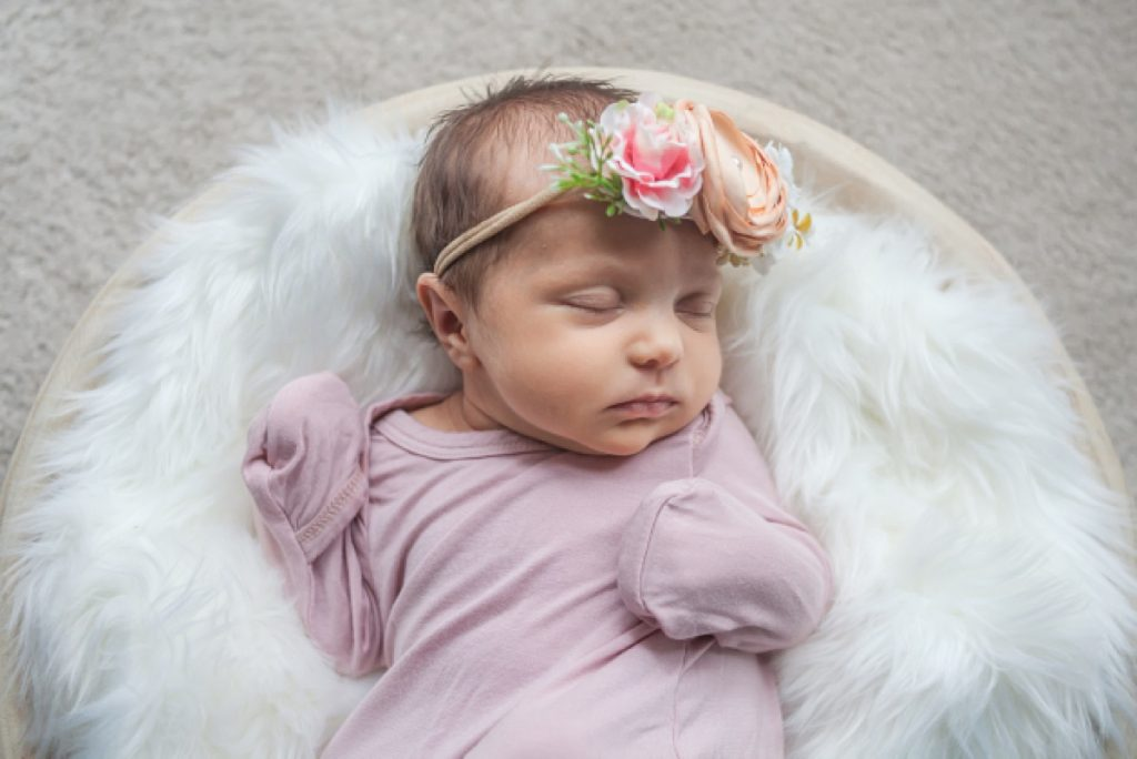 two-week-old in-home newborn photo by kristal bean photography featuring newborn girl in pink gown and tiny flower crown